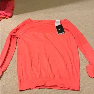 Orange Nike long sleeved dri fit shirt